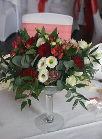 Short martini glass vase with Grand Prix and Amnesia roses, white lisianthus, Granada alstromeria and eucalyptus