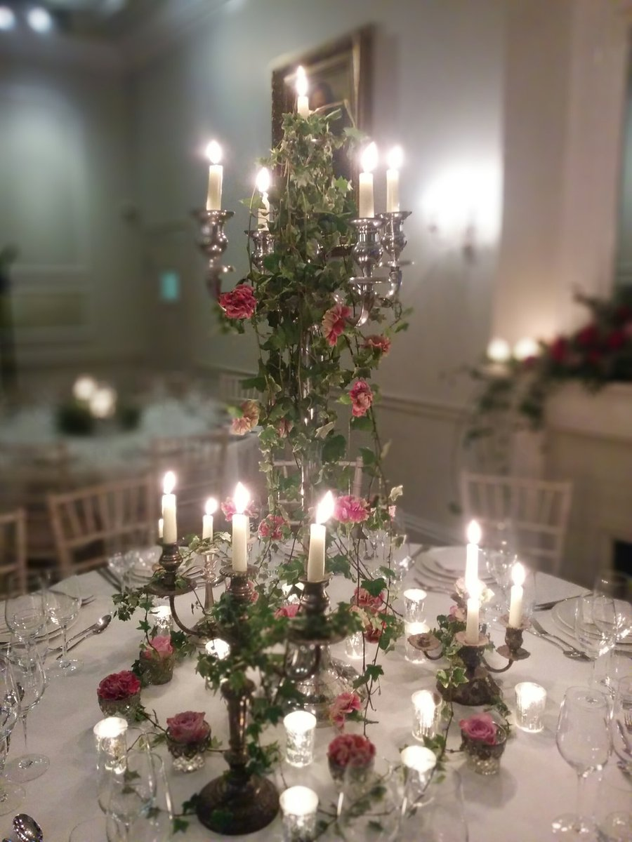 Candelabras with ivy antique pink carnations memory lane roses silver leaf tealights
