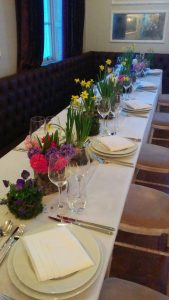 Springtime table with Tete-a-Tete narcissi, violas, hyacinths
